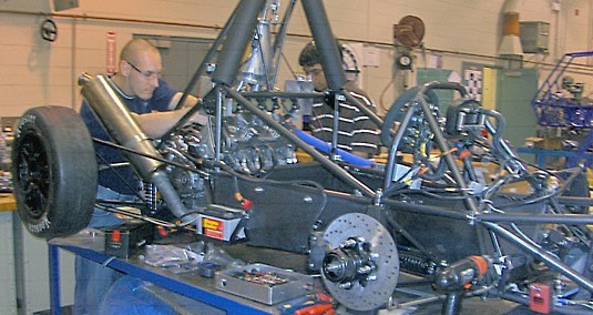 Students learn problem-solving and critical thinking skills through automotive work.